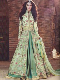 Mystical, magical and mesmerizing, this green wedding outfit by Zoya oozes of royalty and opulence. Accentuated with stunning embellishments, this gorgeous outfit comes with both trouser (pant) and lehanga (skirt) allowing you to show off your personality Floor Length Anarkali, Long Anarkali, Trajes Anarkali, Anarkali Suits Online Shopping, Lehenga Choli, Sari, Marriage Gown, Net Gowns, Types Of Gowns