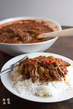 "Share This Post!I had this ropa vieja simmering away in my slow cooker yesterday and it smelled so good I thought I'd go crazy waiting to eat dinner! Even my all-American hubby loves it! I actually just had a big bowl full for lunch again today and I'll probably have it for dinner tonight. Is that excessive? 🙂 If you're not familiar with Ropa Vieja, it's a Cuban dish (actually the national dish of Cuba!) and it literally means ""old clothes"". I'm guessing it's called that because the meat is…"