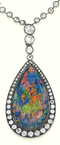 AN ANTIQUE OPAL AND DIAMOND PENDENT NECKLACE The pear-shaped black opal pendant mounted within a circular-cut diamond surround, suspended from a line of graduated collets to the similarly-set diamond collet neckchain, mounted in silver and gold, circa 1890, pendant 7.0cm long, necklace 37.0cm long, in blue leather fitted case by Charig Ltd., London