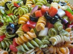 Zesty Italian Pasta Salad - My Recipe - Tri Color Rotini, Black Olives, Cherry Tomatoes, Bell Pepper (green, yellow, red, orange), Red Onion, Chickpeas, Cubed salami, ham, or pepperoni, Grated Parmesan Cheese, Feta cheese and Cubed Cheddar Cheese, Zesty Italian Salad Dressing
