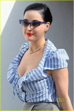 e3dc886ac08 Burlesque star Dita Von Teese shows off her vintage cat s eye shades