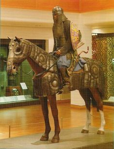 plate armour for man and horse (zereh bagtar and bargustavan), Mughal about 1600. The shield, bowcase, bow and arrows are modern replicas (Royal Armouries)