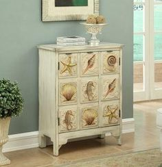 Coast to Coast Shoals Distressed Sand-Drawer Accent Chest at Lowe's. Seahorses, starfish and shells galore on backgrounds of sandy textured panels bring the sea within everyday reach. Finished in our ocean inspired shoals Space Furniture, Kitchen Furniture, Coastal Furniture, Furniture Ideas, Kitchen Dining, Dresser As Nightstand, Wood Species, Sea Shells, Home Improvement