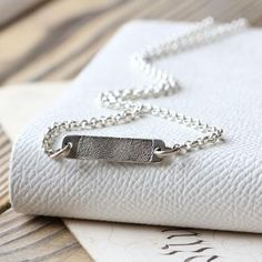 Inked Fingerprint Bar Necklace - A unique necklace with your loved ones fingerprint on a dainty silver pendant. Capture your loved ones fingerprint on a dainty silver pendant suspended on an elegant British made silver belcher chain. Perfect for keeping loved ones, young or old, close to you at all times, even when you have to be apart.