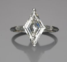 A diamond ring centering a lozenge-shaped diamond, weighing approximately: carat; mounted in platinum Geek Jewelry, I Love Jewelry, Jewelry Rings, Jewelry Accessories, Jewelry Design, Or Antique, Antique Jewelry, Vintage Jewelry, Ring Set