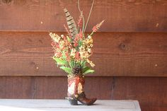 cowgirl boots with flowers as a vase | Handmade WESTERN decor FLORAL flower ARRANGEMENT by jensdesigns10