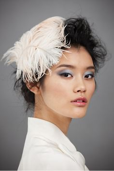 Fancy-Takes-Wing Headband $300.00 from BHLDN. I'm actually more enamored with the makeup! Gorgeous.