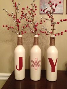 Wine bottle holiday decor using spray paint and a hot glue gun.