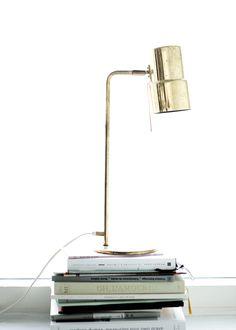 Bedside table lamp in brazen