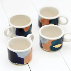 Sit in your modern, organic and warm kitchen with a cup of coffee or espresso in one of our handpainted Glacier porcelain tumblers in navy blue