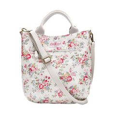 A hands-free option for shopping, school or work, with room for all the essentials.  1 internal zip pocket 1 external zip pocket adjustable cross-body strap grab handles shiny oilcloth