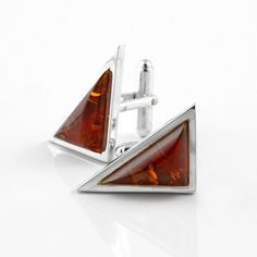These cuff links were hand crafted in Russia from honey amber stones set in sterling silver cases. Look stunning on any shirt.