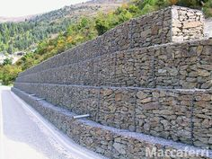 Gabions: form of earth retention in which corrosion resistant wire baskets are filled with cobble or boulder sized rocks and then stacked to form retaining walls, slope protection, and similar structures.