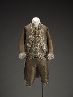 man's three piece suit comprising Frockcoat, waistcoat and breeches.  French, ca. 1775, silk. This three-piece man's suit is exquisitely embroidered in highly stylized floral motifs. The delicate arrangements of flowers include lavender, rosemary, dianthus blooms and arum leaves.