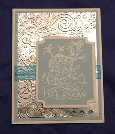 pretty filigree snowman stamp and embossed aluminum foil.