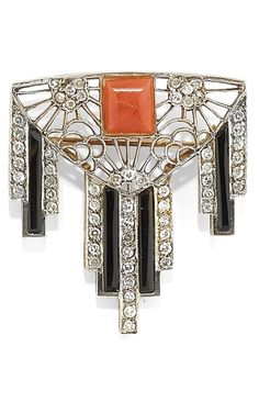 AN ART DECO GOLD, PLATINUM, CORAL, ONYX AND DIAMOND BROOCH, CIRCA 1930. #ArtDeco #AntiqueJewelry