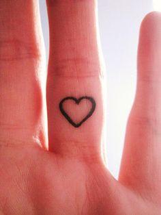 Heart tattoo inside finger.