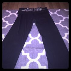 Small Full length black Victoria Secret yoga pants Victoria Secret long black yoga pants with angle wing embellishment on the rear elastic fold. 87% cotton 13% elastane. Good for lounging or work out! No pets or smoking the house. Washed in color protective detergent Victoria's Secret Pants