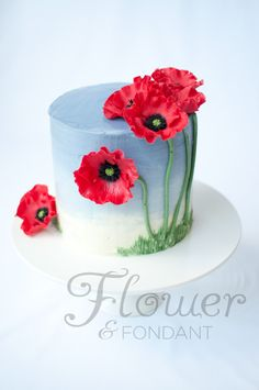 Poppy cake. Really cute simple cake with a mix of 2D and 3D. Love the flowers and blue sky effect.