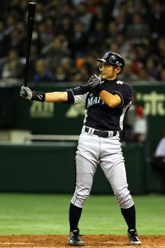 Ichiro Suzuki does his signature move during the preseason game between the Yomiuri Giants and Seattle Mariners at the Tokyo Dome on March 26, 2012, in Tokyo. (Koji Watanabe / Getty Images)