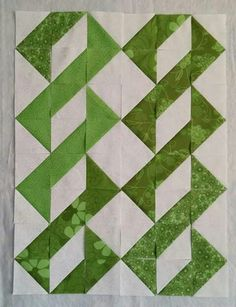 Half square triangles. You could put a a strip of sashing in between vertically.