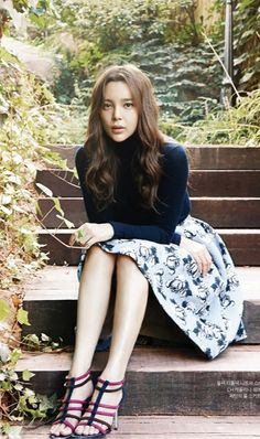 Park Si Yeon. InStyle Korea - Oct 2014. Floral print full skirt, black turtleneck sweater, multicolored strappy heels.