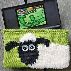 Aww cute! Knit a Shaun the Sheep case