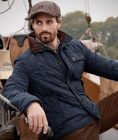 Fall combo inspiration with a navy quilted jacket gingham flatcap brown  corduroy pants flannel shirt 5da832e7c