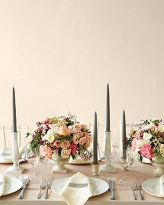 Timeless Centerpiece | Low centerpieces of jasmine, wax flower, Queen Anne's lace, lisianthus, and blush-hued garden roses are sophisticated yet warm.Timeless Centerpiece