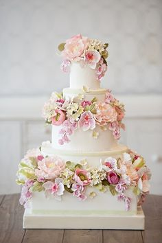 A variety of summer flowers in soft colors make this cake spectacular.