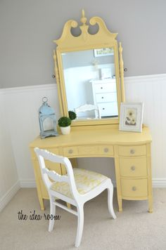 Gorgeous yellow painted dresser, grey walls