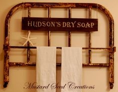 Old Iron Headboard turned into a towel  bar - Love this idea for the bathroom!