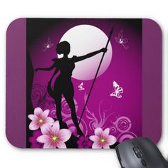A mouse pad with a Nighttime silhouette of a woman and blooming flowers, full moon and flying butterflies a fairy Goddess, who is a warrior, with a long spear and short dress link http://www.zazzle.com/goddess_mousepad-144773092896211505
