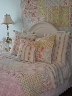 So pretty-hang a quilt above the bed instead of a headboard.  The lamp begs for a pretty lacy, ruffly shade though.