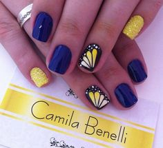This totally cute and attractive nail art design plays around with yellow, midnight blue and dark polish. It's really eye catching and the butterfly wings are just simply adorable. The nails are coated with matte midnight blue and yellow and topped with glitters for accent. The butterfly wings are then painted over a black nail polish making it look distinctive from further away.