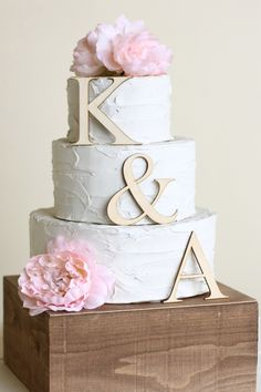 19. Highlight your entire cake with this natural wood 3 piece cake topper from…