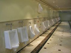 What Wally uses the high up Wall urinal ? Is it a game to see how 'accurate' is your aim and how much pressure you have ie = bursting = start on high up urinal, then as 'pressure' diminished by only half full bladder, step to one side and use ordinary urinals ?