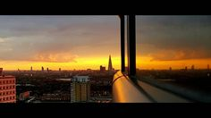 Sunset from Canary Wharf over the city of London.  #london #sunset #orange #sun #evening #canarywharf #hues #sillouette #theshard #theshardlondon #cityoflondon #nature by rsklondon