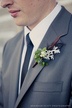 boutonniere with feathers, dusty miller, and greenery