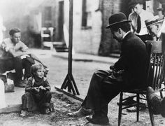 Charlie Chaplin interviewing a young vaudeville actor to co-star with him in The Kid, Los Angeles, 1920