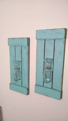 This is for a SET OF TWO rustic shutter sconces. These are an amazing statement piece for any room. They are versatile and can be filled with different types of flowers or feathers throughout the year to change up their look. These were made with hand-selected pine wood that have built into a solid design that will last forever. It is featured here in our North Coast Paint and Sanded and Distressed for a Rustic Look; however, we have may different paints or stains to choose from. The…