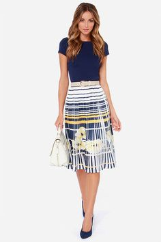 """Pleats Believe Me Ivory Print Midi Skirt! A fitted black elastic waistband offers a perfect fit on this silky woven midi skirt. A beautiful gold, ivory, and navy blue striped pattern with a yellow floral print parades down cute accordion pleats. Belt is not included. Skirt is lined. Model is 5'9"""" and wearing a size small. 100% Polyester. Hand Wash Cold. Imported."""