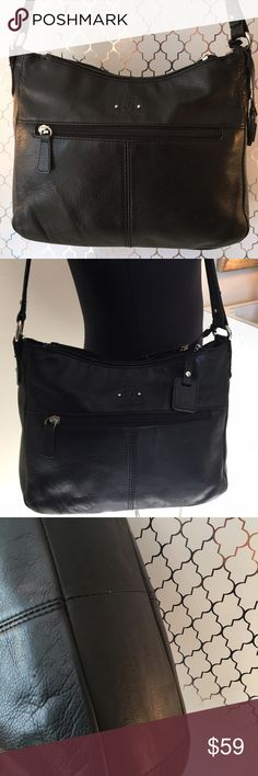 🎁SALE! STONE MOUNTAIN SHOULDER BAG 💯 AUTHENTIC STONE MOUNTAIN SHOULDER BAG 100% AUTHENTIC. STUNNING AND ALWAYS STYLISH. GREAT BAG FOR ANY OCCASION. TWO EXTERIOR POCKETS, THREE LARGE MAIN COMPARTMENTS, AND 4 INTERIOR POCKETS. THE BAG MEASURES 11 INCHES WIDE BY 9 INCHES TALL. THE ADJUSTABLE SHOULDER STRAP HAS A 10 to 14 INCH DROP Stone Mountain Bags Shoulder Bags