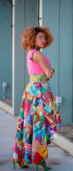 Slay mama! This African wax print high low skirt is irresistible! Everything about this skirt is classy and vibrant. Now I see why African print is all the rave. I need this patchwork beauty in my wardrobe. Ankara, Dutch wax, Kente, Kitenge, dashiki, ankara maxi skirt, African fashion, African clothing, African prints, Nigerian style, Ghanaian fashion, bomber jacket, Kenya fashion, Nigerian fashion