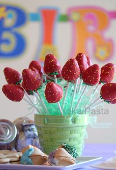 Strawberry Cake Pops. Could put ice the container to keep them from melting for an outdoor party.