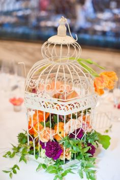 With bird cages from OKL; use Alabama and Virginia cups for smaller vases on the table.
