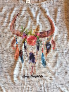 Beautiful watercolor skull on loose fitting, boxy T.  Perfect for summer! Classy Cowgirl Co- Gypsy Cowgirl ,Fun & Funky Western clothing, jewelry, & Acc