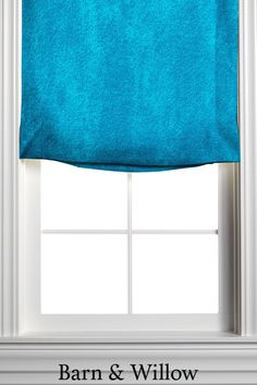 Made of velvet, this custom window shade is hand-stitched by expert hands and adds a touch of texture and style to any room. Relaxed Roman Shade, Custom Roman Shades, Window Coverings, Velvet, Hands, Touch, Texture, Room, Fabric