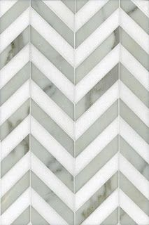 marble tile in chevron pattern.  so fun!  probably too trendy?