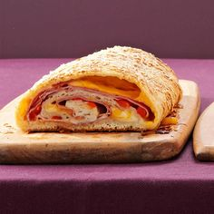 "Spiral Stromboli Recipe -""I frequently fix this speedy sandwich on days we return from our cabin and it's suppertime when we get home,"" writes Jean Gruenert, Burlington, Wisconsin. The stuffed loaf takes advantage of refrigerated dough, so it's easy to assemble for a meal, appetizer or late-night snack."
